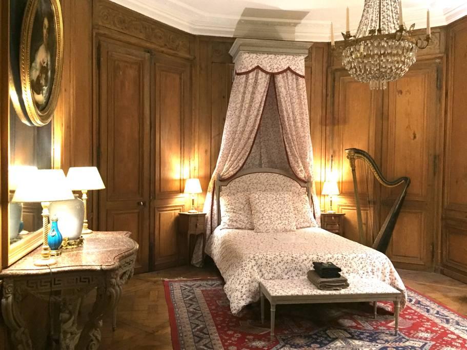 wood panelled bedroom in paris