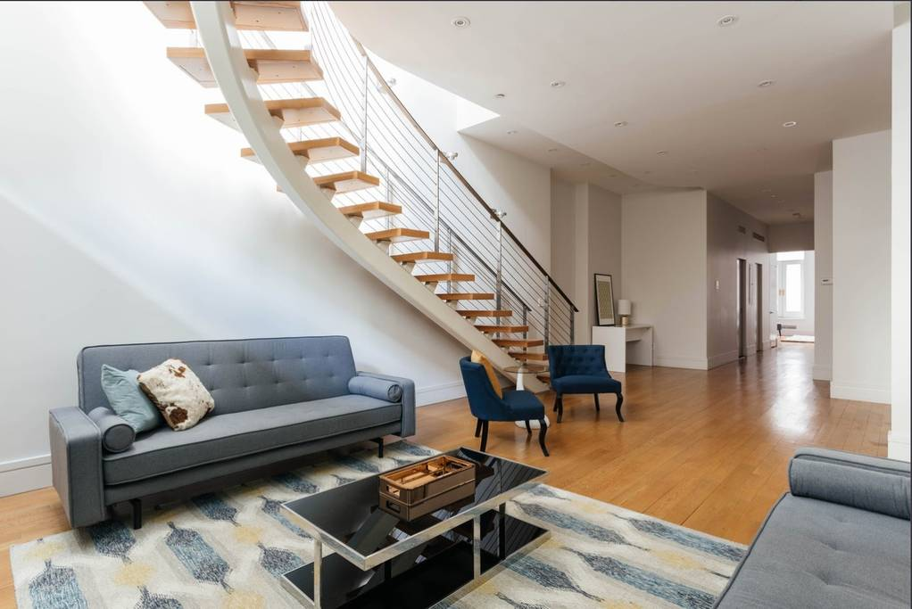 airy new york townhome with floating staircase airbnb