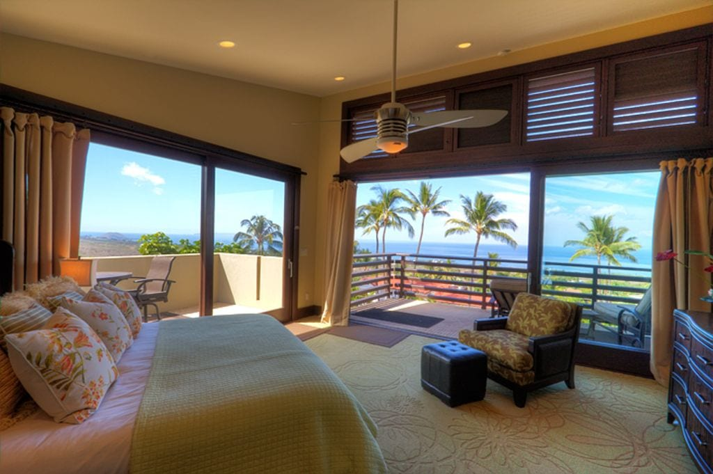 a view of palm trees from the bedroom