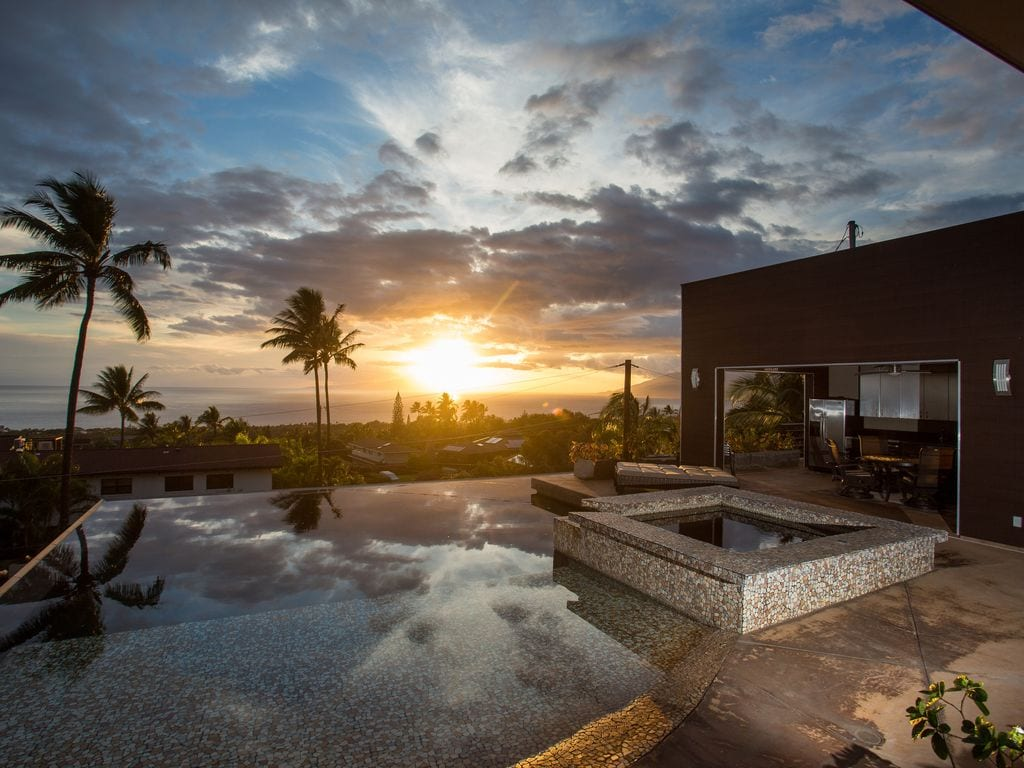 a sunset over the pool in Maui