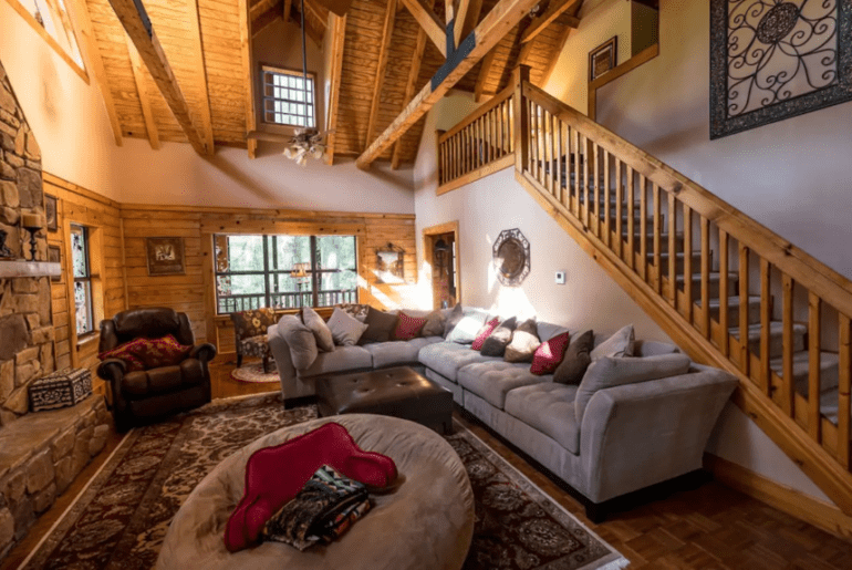The livingroom has rustic decor and comfortable couches