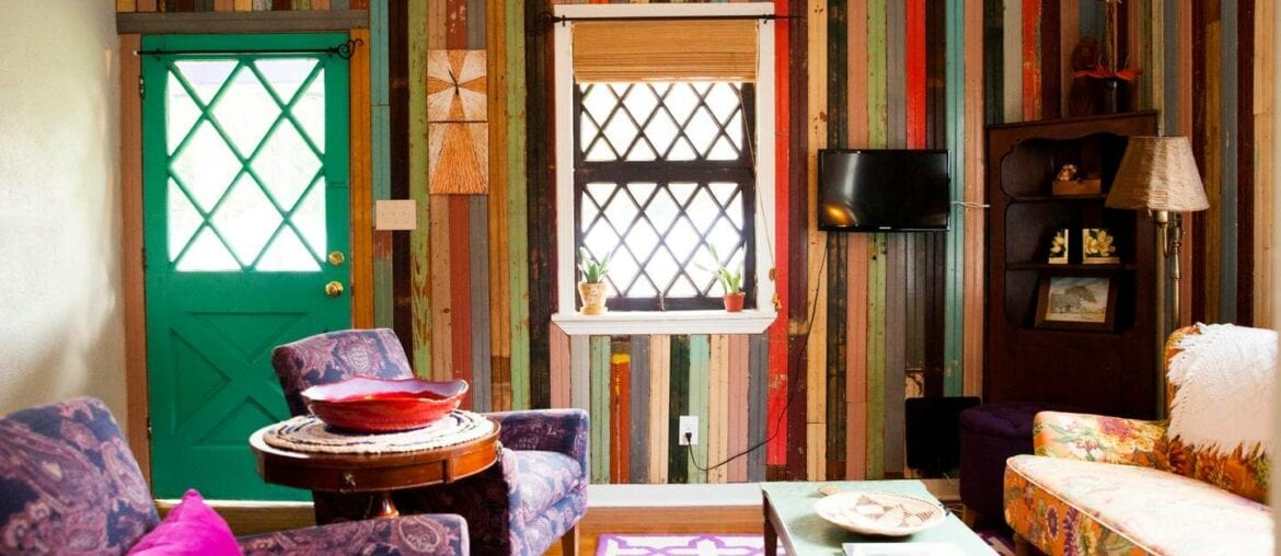 The vibrant, multicolored walls give this home a unique vibe