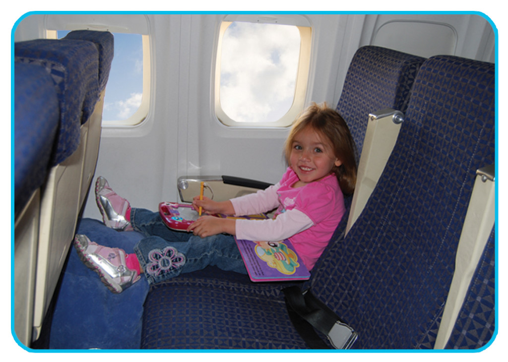 1st Class Kid Travel Pillow Inflatable Footrest and child on plane