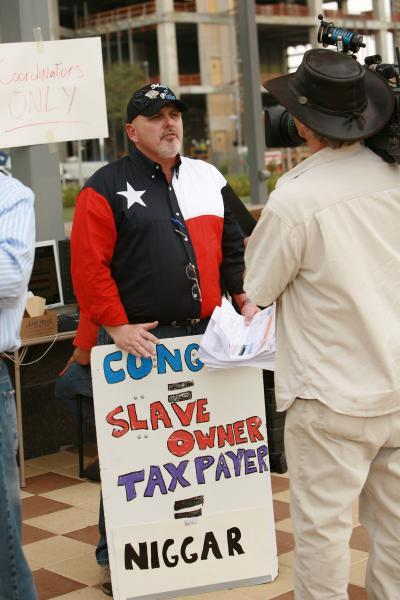 """Vitriolic Past: The self-proclaimed founder of TeaParty.org carried a controversial sign at the February 27, 2009 Tea Party in Houston. The word at the top of the sign is """"Congress."""" (Image courtesy of the Washington Independent)"""