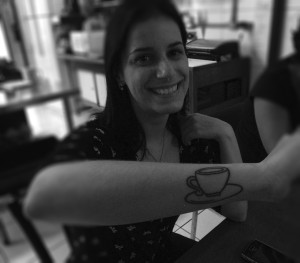 Coffee tattoo on arm of customer