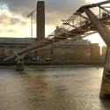 Millenium Bridge over Thames river, London at sunset