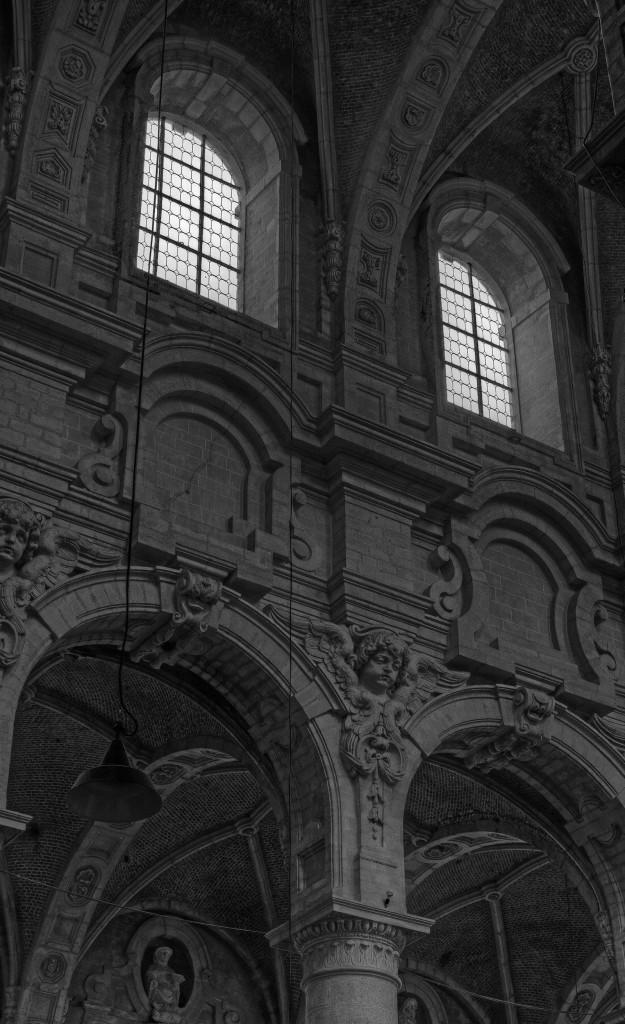 Lit Windows above a dark church interior - Brussels, Belgium