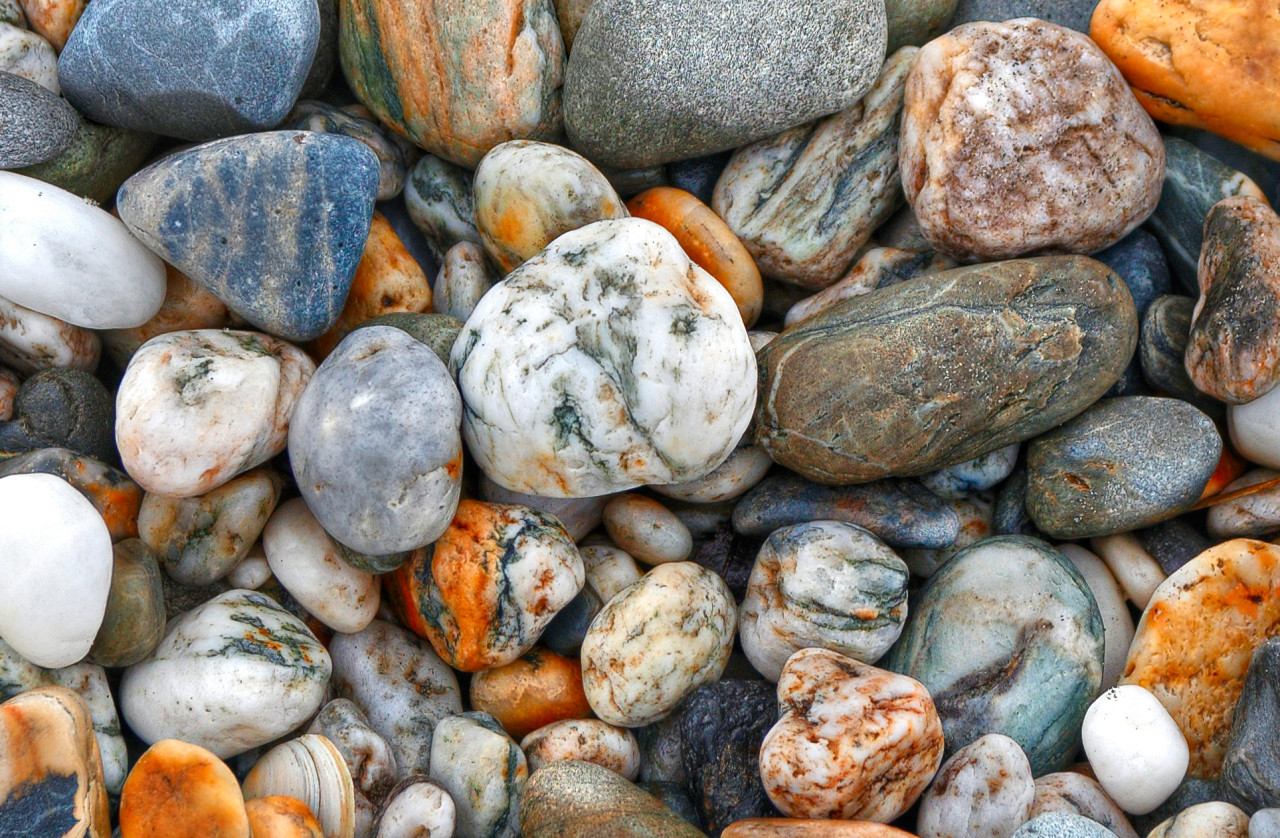 brilliantly coloured smooth rocks on the beach.