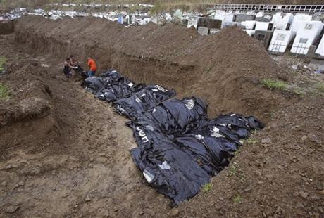 Mass burial held in Philippine city hit by typhoon