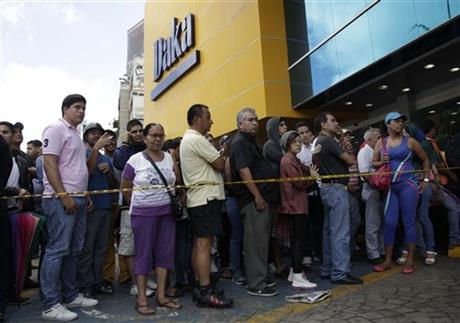 Venezuelan shoppers amass outside seized stores