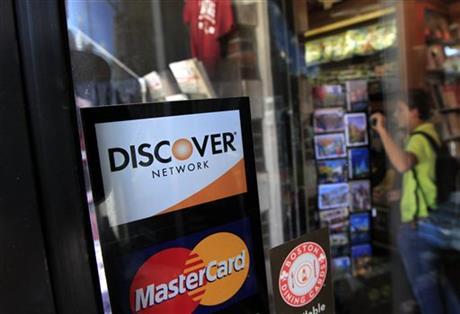 DISCOVER FINANCIAL'S 2Q PROFIT JUMPS 7 PERCENT