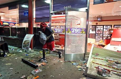 VANDALISM, LOOTING AFTER VIGIL FOR MISSOURI Michael Brown