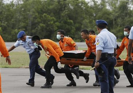 Bad weather hobbles Indonesia jet recovery; 7 bodies found