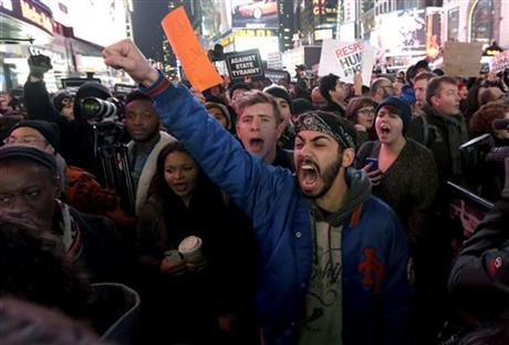 Protests erupt as cop cleared; feds to investigate