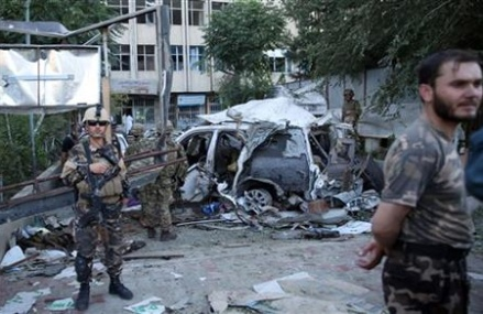 Afghan suicide car bombing targeting NATO convoy kills 12