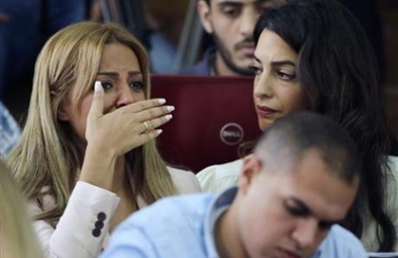 The Latest: Al-Jazeera vows to free journalists in Egypt