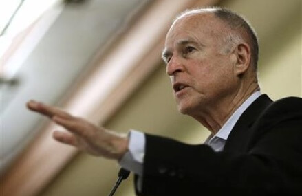 Fired regulator: Brown pushed to waive oil safeguards.
