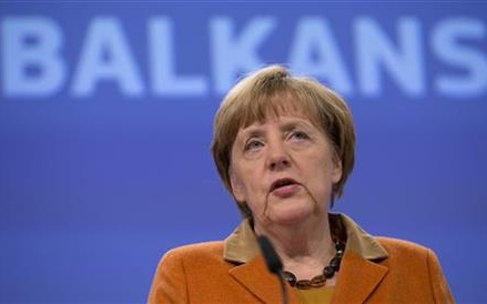 The Latest: Merkel confident Germany can integrate refugees
