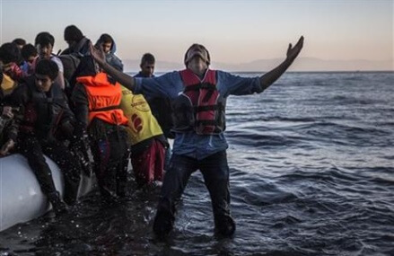 The Latest: German official: Don't link terrorism, refugees