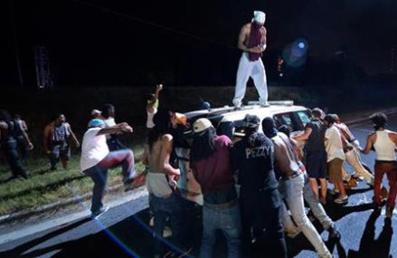Protesters in police shooting injure officers, shut highway