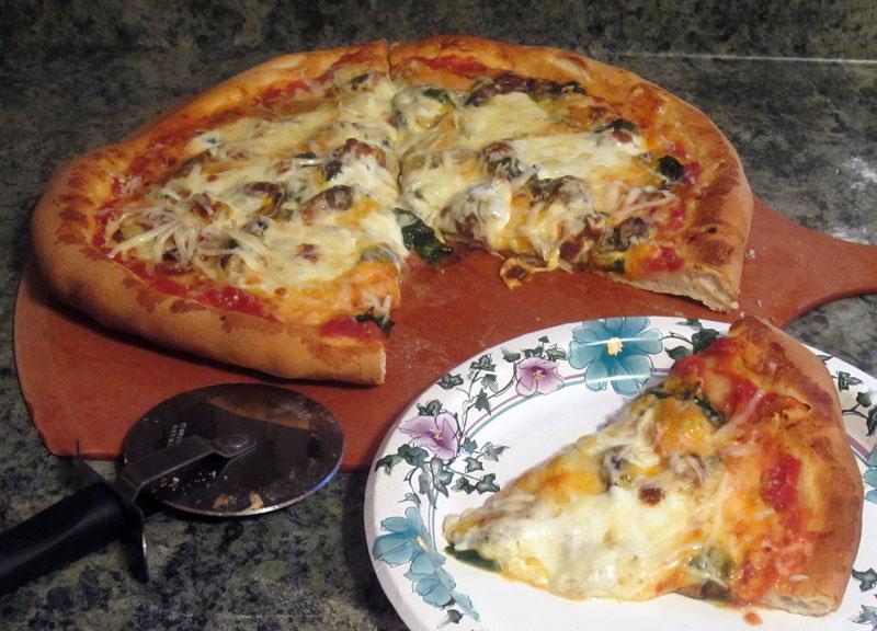cheesy smoked oyster pizza