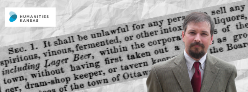 A man wearing a suit is posed in front of text from an 1866 ordinance about alcohol in Ottawa.