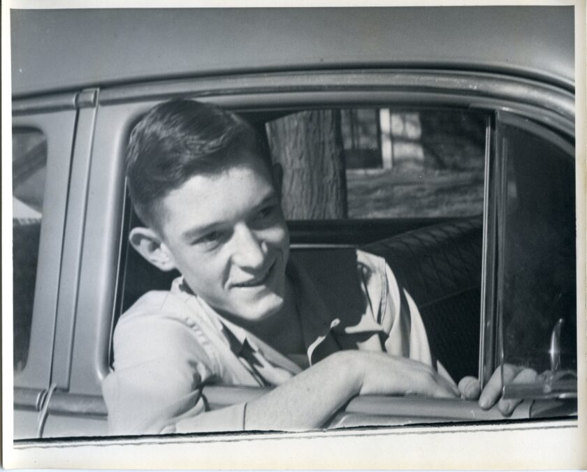 In this self-portrait, teenaged Jack Bremer leans out of an open car window.