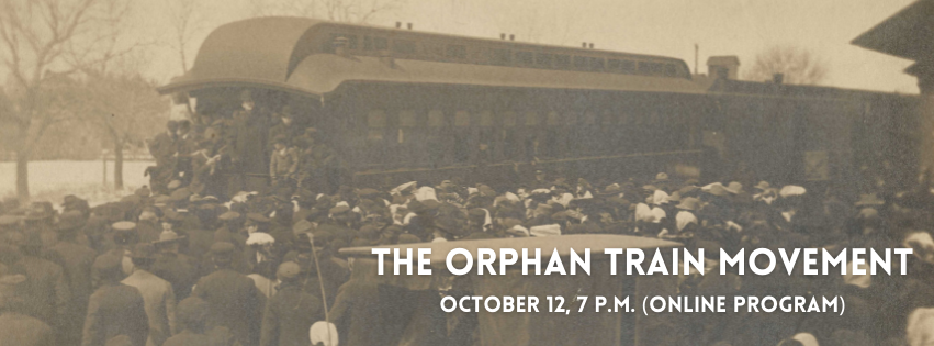 A train pulls into a station. A crowd of people gather around as passengers disembark.