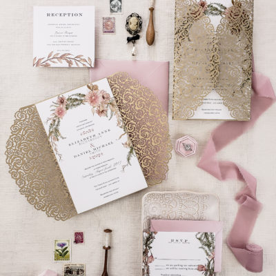 botanical laser cut wedding invitation suite with spring floral and flower laser cut wrap in gold, blush and gold wedding invitation sample