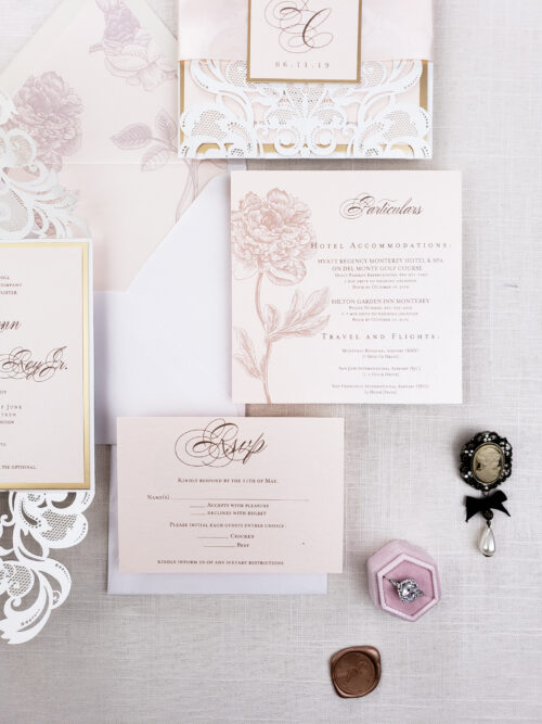 white laser cut invitation