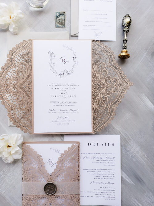 blush laser cut wedding invitation