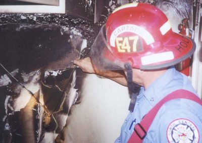Holt examining fire scene