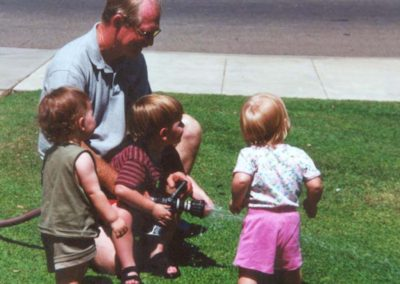 Ron shooting water with children