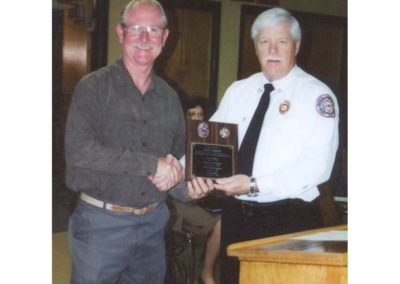 Ron with chief Daugherty accepting plaque