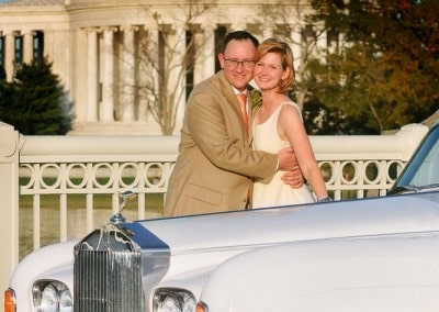 Photo of newlyweds with the 1964 Rolls Royce in front of the Jefferson memorial.