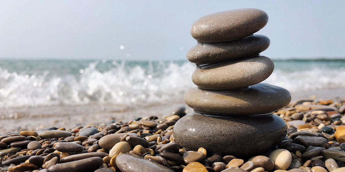Photo of stacked stones on the beach
