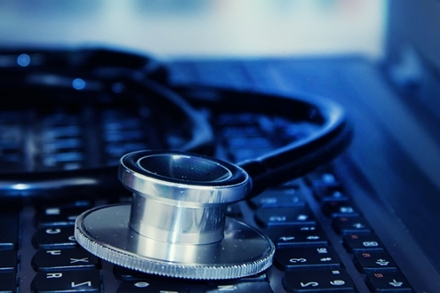 Stethoscope on top of laptop keyboard