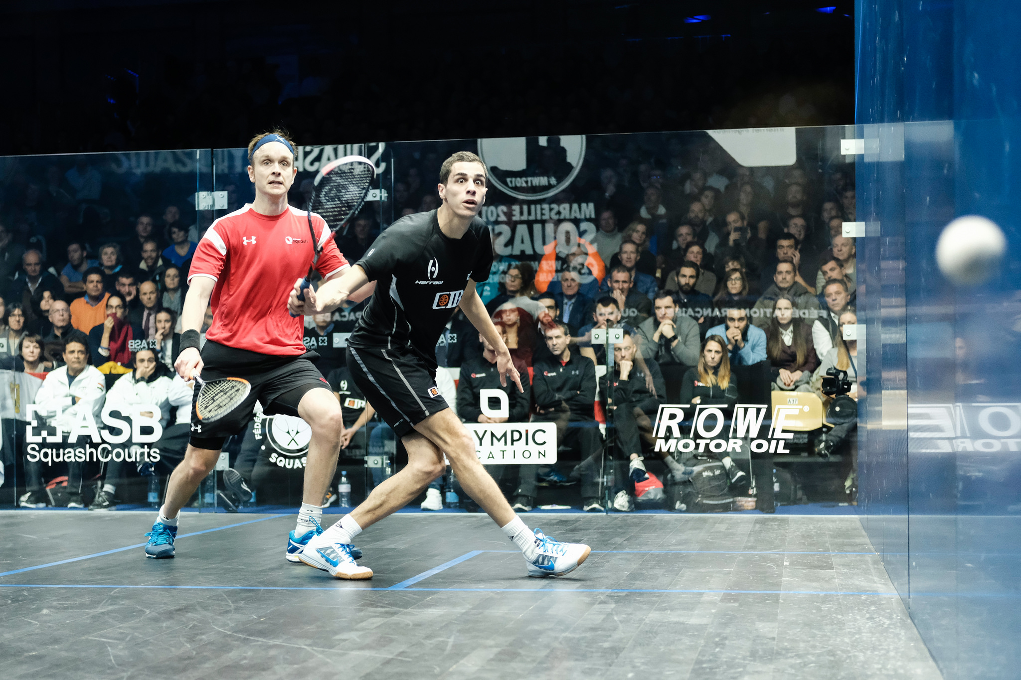 James Willstrop of England and Ali Farag of Egypt go head-to-head during the 2017 WSF Men's World Team Squash Championship final in Marseille, France.