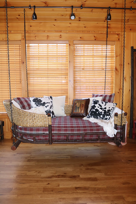 hanging porch swing lakeside living red plaid dalmatian print pillows woven siding wi