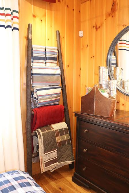 ladder draped with blankets lake cabin warm inviting fun decor