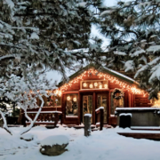 Lakeside-Living_Manitowish-Waters-WI_How-to-Show-Your-Loved-Ones-You-Care-This-Holiday-Season_Cabin-in-the-Woods-with-Christmas-Lights