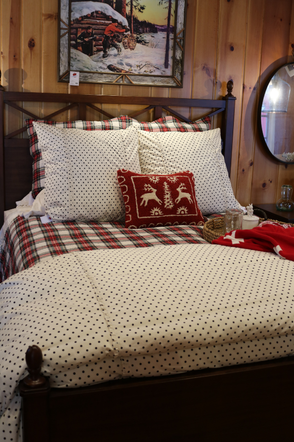 Lakeside-Living_Manitowish-Waters_Northwoods-WI_What-it-is-Really-Like-to-Work-with-an-Interior-Designer_Rustic-Cabin-Bedroom-with-Local-Throw-Pillow