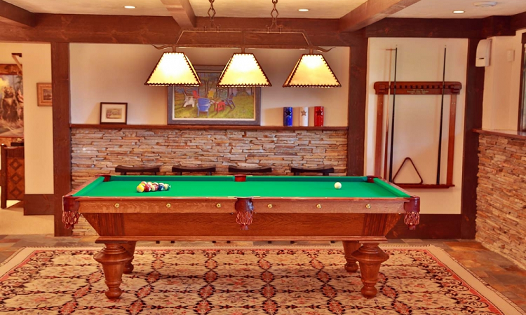 Lakeside-Living_Manitowish-Waters_Northwoods-WI_What-it-is-Really-Like-to-Work-with-an-Interior-Designer_Billiards-Room-in-Cabin-Basement