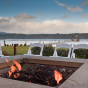 Lakeside-Living_Manitowish-Waters-Wisconsin_Northwoods-Interior-Design-outdoor-fire-table-selection-fire-table-on-a-lake-with-white-event-chairs