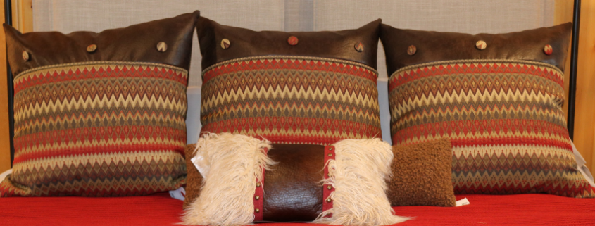 lakeside-living-design-northwoods-wi-cabin-decor-patterned-pillows-reds-orange-brown-diamond-fabric