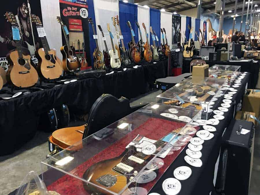 Vintage guitars, vinyl records, and rock memorabilia at Grayslake Antique Market August 10 & 11