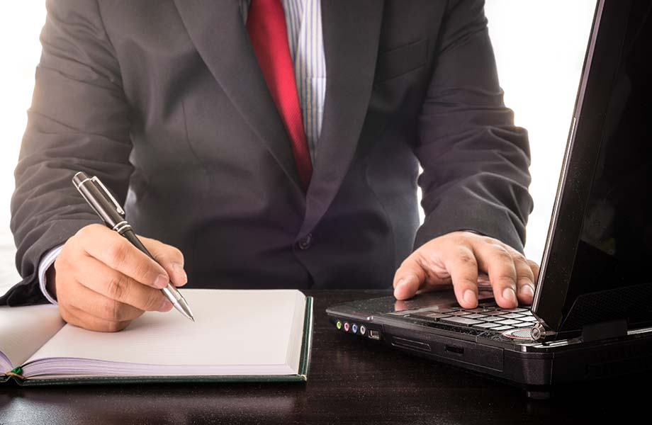 business man working with laptop, close up of hands hold a pen of business man