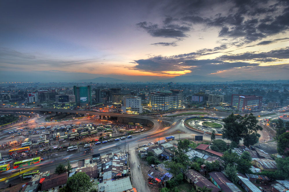 The hectic chaos of construction and city growth showing Megenanya during a sunset in the rainy season - Addis Ababa, Ethiopia