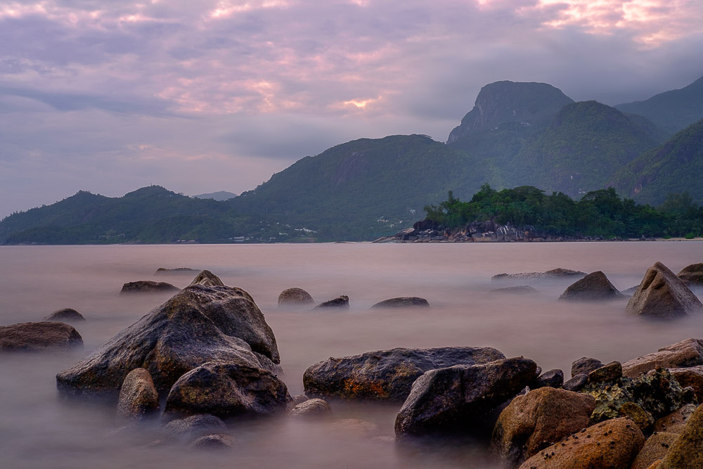 Long exposure of sea and boulders on Barbarons Beach in Seychelles
