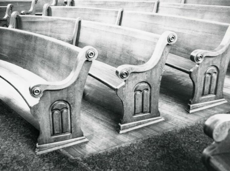Oak, carved pews, as photographed for the National Registry in 1980